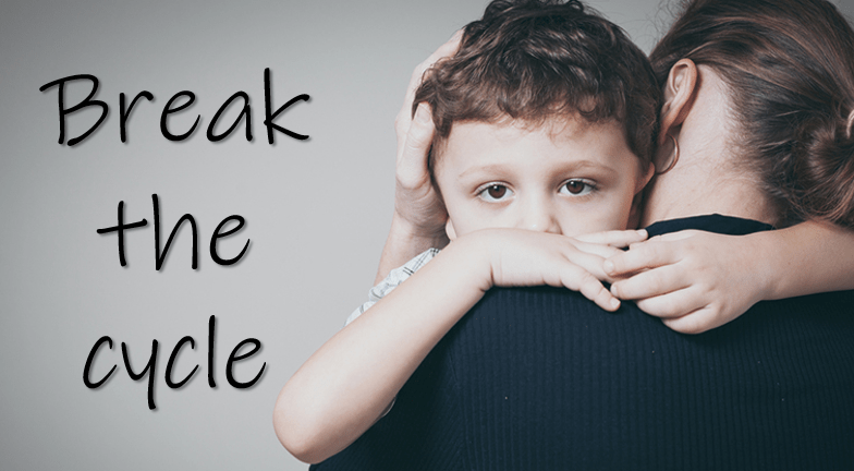 "a worried young male child who is hugging and being hugged back by his mother can only see part of his face and the back of her head, there is text ""break the cycle"" on the left side."